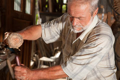 Carpenter and hammer Royalty Free Stock Images