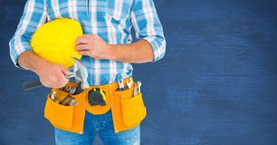 Carpenter with hammer against blue blackboard Stock Images