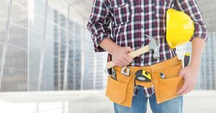 Carpenter with hammer against window Royalty Free Stock Images