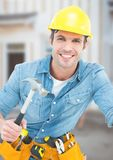 Carpenter with hammer on building site Royalty Free Stock Image