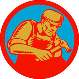 Carpenter With Hammer Circle Woodcut. Illustration of a carpenter with hammer set inside circle on  background done in retro woodcut style Stock Images
