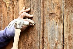 Carpenter hammer in a nail Stock Photo
