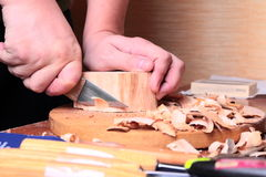 Carpenter hand carving wood Royalty Free Stock Image