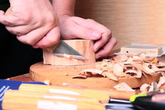 Carpenter hand carving wood Royalty Free Stock Images