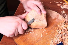 Carpenter hand carving wood Royalty Free Stock Photo