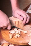 Carpenter hand carving wood Royalty Free Stock Photography