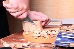 Carpenter hand carving wood Stock Photos