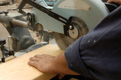 Carpenter hand and  saw. In time of  work Stock Image