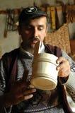 Carpenter handcrafting a wooden alpenhorn Stock Photography