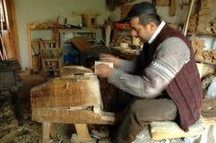 Carpenter handcrafting a wooden alpenhorn Stock Photo