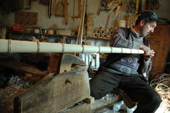 Carpenter handcrafting a wooden alpenhorn Stock Images