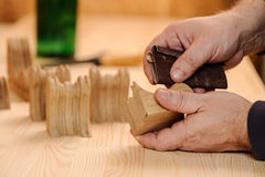 Carpenter hands polishing wood with sandpaper Royalty Free Stock Images