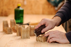 Carpenter hands polishing wood with sandpaper Royalty Free Stock Photography