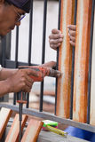 Carpenter hands using electric drill on fence wood Royalty Free Stock Photo