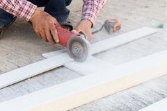 Carpenter hands using electric saw on wood Royalty Free Stock Images
