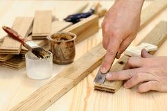 Carpenter hands at work with chisel. Closeup royalty free stock photos