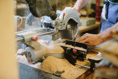 Carpenter hands working in furniture wood industry Stock Photo