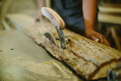 Carpenter hands working in furniture wood industry Royalty Free Stock Image