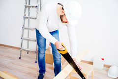 Carpenter with a handsaw Stock Image