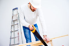 Carpenter with a handsaw Royalty Free Stock Images