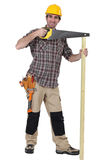 A carpenter with a handsaw. Stock Images