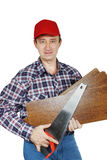 Carpenter with handsaw and woods Stock Photos