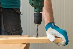 Carpenter handyman using electric drill Royalty Free Stock Photos