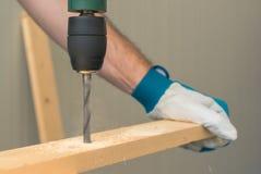 Carpenter handyman using electric drill Stock Photo