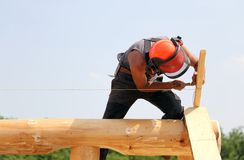 Carpenter with helmet and protective equipment to work safely on Royalty Free Stock Photo