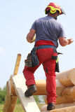 Carpenter with helmet and protective equipment to work safely on royalty free stock images
