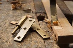 Carpenter with a hinge Stock Photography