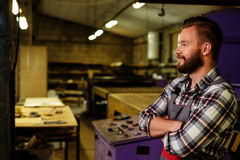 Carpenter on his workplace in carpentry workshop Stock Photography