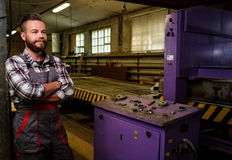 Carpenter on his workplace in carpentry workshop Royalty Free Stock Photos