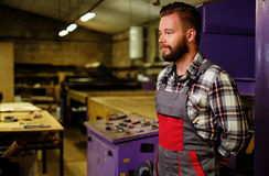 Carpenter on his workplace in carpentry workshop Royalty Free Stock Image