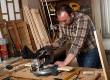 Carpenter in his workshop. Royalty Free Stock Photography