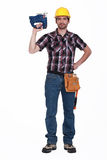 Carpenter holding chainsaw. Carpenter holding a powerful chainsaw Royalty Free Stock Images