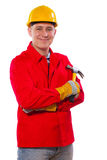 Carpenter holding claw hammer looking at camera and smiling isol Royalty Free Stock Photo