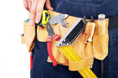Carpenter holding different tools on his belt Royalty Free Stock Images