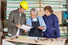 Carpenter Holding Digital Tablet While Discussing Stock Images