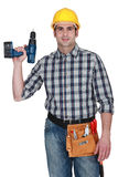 Carpenter holding  drill Royalty Free Stock Photos