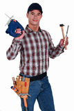 Carpenter holding drill Stock Photography