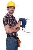 Carpenter holding electric saw Stock Photos