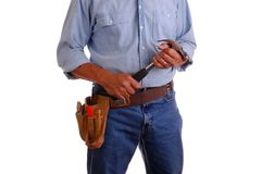 Carpenter holding hammer Stock Images