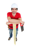 Carpenter holding hand-saw Royalty Free Stock Photos