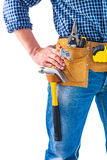 Carpenter holding hand on toolbelt with tools. Construction concept Stock Images