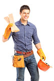 Carpenter holding a helmet and sills. A smiling manual carpenter holding a helmet and sills isolated on white background Stock Photos