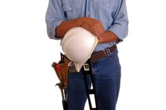 Carpenter holding level & hard Royalty Free Stock Photos