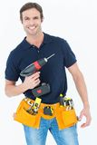 Carpenter holding portable drill machine Royalty Free Stock Photography