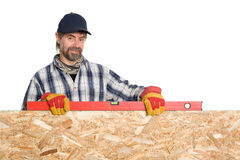 Carpenter holds level Royalty Free Stock Image