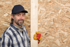 Carpenter holds a plank Royalty Free Stock Photo